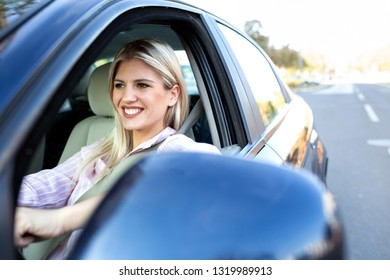 Young girl with a big smile on her face driving a cool car