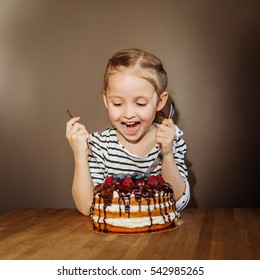 young girl at birthday with cake. Studio shot
