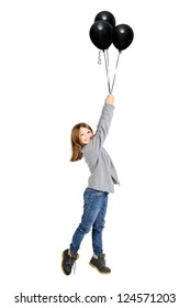 Young girl with black balloons isolated in white