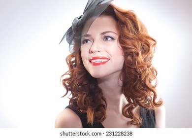 Young girl  in a black dress on a white background, retro image, studio portrait
