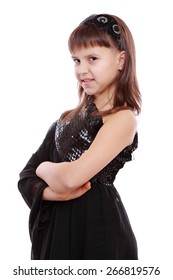 Young girl in a black dress on Holiday theme