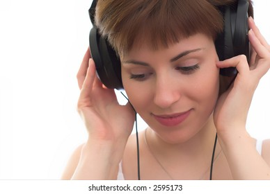 young girl with black ear flaps on white