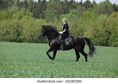 Young girl with black horse