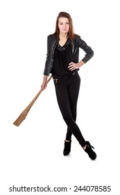Young girl in black leather jacket and high heels holding wooden club isolated over white background