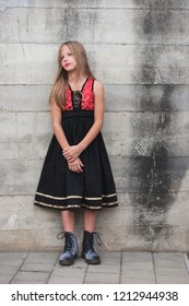 Young girl in a black and red dress