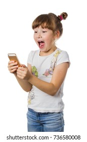 A young girl with blond hair is holding phone and sends funny message. white isolated background