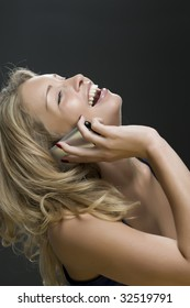 young girl a blonde  talks on a mobile telephone 4