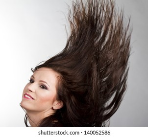 young girl with blowing hair