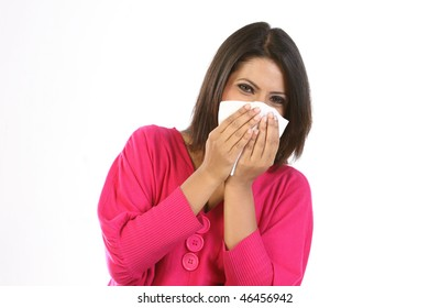 Young girl blowing her nose at tissue