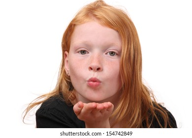 Young girl blows a kiss on white background