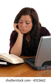 A young girl bored with her studies