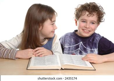 Young girl and boy doing homework