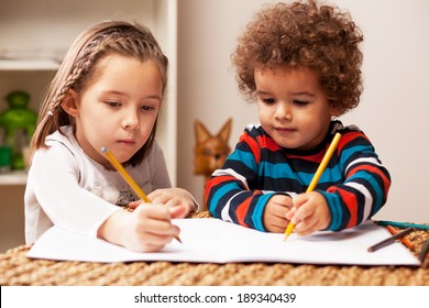 Young girl and boy drawing