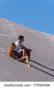 A young girl and boy, on some natural dunes