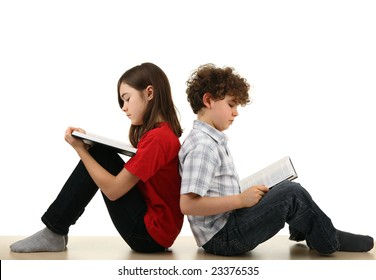 Young girl and boy reading book isolated on white background