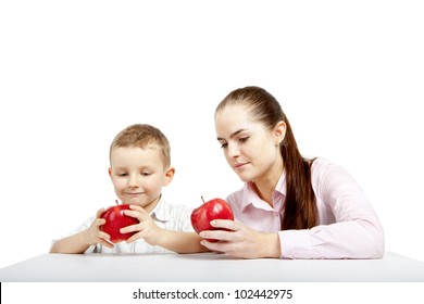 Young girl and boy sitting and watching the apples that will they eat for the moment.