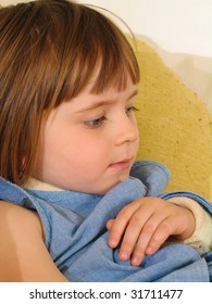 A young girl with a broken arm in a sling. Close-up portrait, indoors.