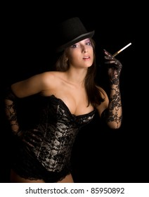 The young girl in a bronze corset smoke and licks lips