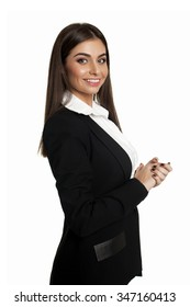 Young girl in business black suit looking at the camera in studio