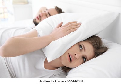 Young girl can't sleep because of her man's snoring