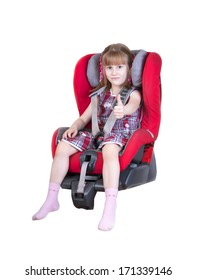 Young girl in car seat with thumbs up, isolated on white background