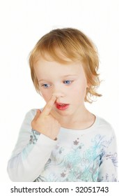 A young girl caught in the act of picking her nose