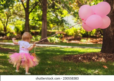 Young girl celebrating her first birthday in the park -- image taken at San Rafael Park in Reno, Nevada, USA