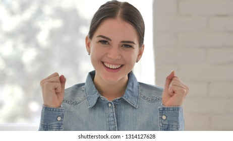 Young Girl Celebrating Success  Gesture in Office