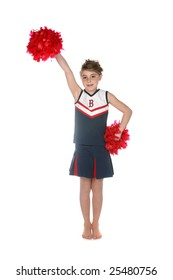 young girl in cheerleader outfit holding pompoms