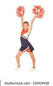 Young girl cheerleading with orange pompoms