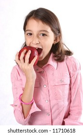 young girl / child with eating fresh red apple against white background