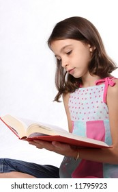 Young girl / child enjoying reading a book