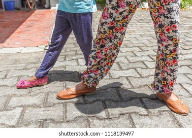 young girl children's seen wearing colorful modern unidentified footwear.standing in different styles and poses for a photograph with selective focus.wearing leggings and standing on their own shadow