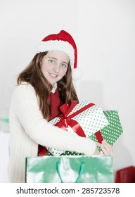 Young girl with Christmas presents