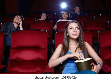 A young girl at the cinema