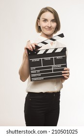 young girl with a clapperboard cinema