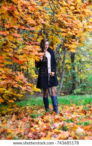 6203049e7 Young Girl Classic Black Coat Blue Stock Photo (Edit Now) 743685178 ...