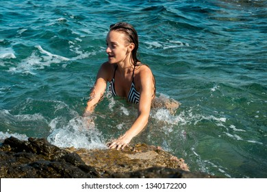 young girl in the clear blue sea