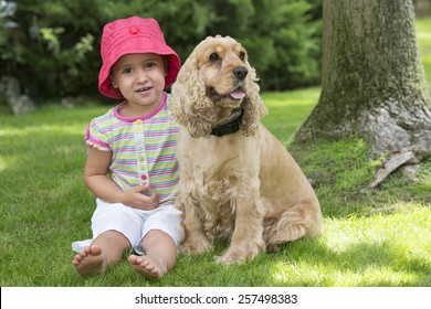 Young girl with cocker spaniel dog on field