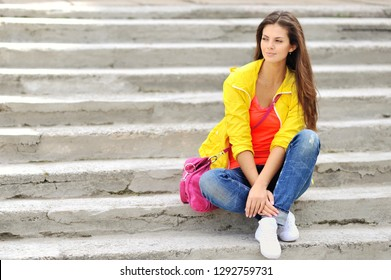 Young girl in colorful clothes - outdoor street portrait
