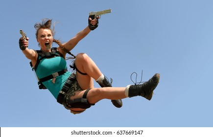 A young girl comes alive when she gets dressed up  as  a combat action girl. She poses outdoors and makes  a  good attempt at acting the part.