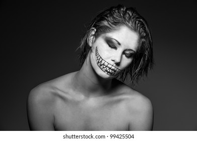 a young girl with creative face paint