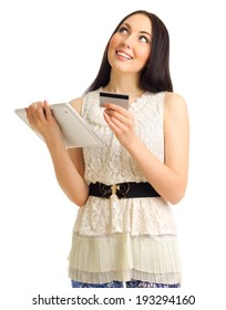 Young girl with credit card and tablet PC isolated