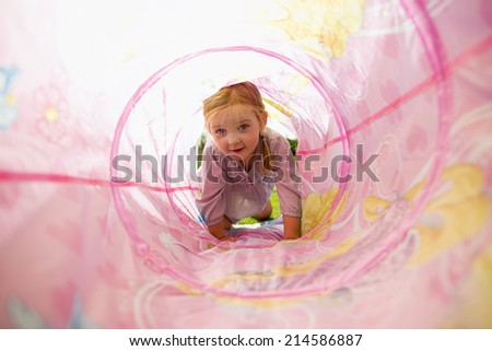 Cute blonde explores her tunnel with a toy