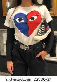 Young girl with custom t-shirt and sport shoes