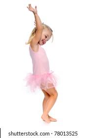 young girl dances ballet in her ballerina tutu, isolated on white in studio