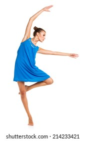 Young girl dancing in a blue dress on a white background