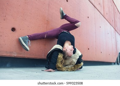 Young girl dancing breakdance on the street.