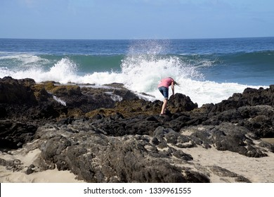 Young girl dangerously close to the edge of Thor's Well, Cape Perpetua, Oregon coast