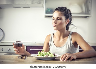 young girl deciding whether to eat healthy food or a sweet